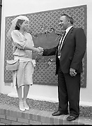"Best Dressed Lady at Phoenix Park Races.1984..11.08.1984..08.11.1984.11th August 1984..A competition,sponsored by V'Soske Joyce,was held at the Phoenix Park Racecourse,Dublin.The prize of a hand tufted rug was awarded to the ""Best Dressed Lady"" on Ladies Day at the racecourse. The eventual winner was Brianne Leary from Los Angeles,California..Image of Ms Brianne Leary taken with the Sponsors Director, Mr Michael Dixon as they pose in front of her prize, a hand tufted Rug."