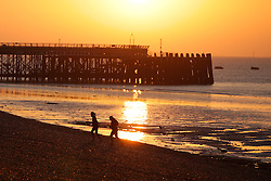 © Licensed to London News Pictures. 01/10/2015. Southsea, Hampshire, UK. Two women training during sunrise on Southsea beach in Portsmouth this morning, 1st October 2015, on what is set to be another dry and fine day in the south of England. Photo credit : Rob Arnold/LNP