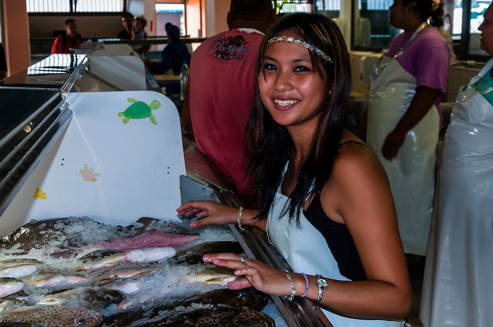 Young woman selling fish in the local market, Noumea, Grand Terre, New Caledonia