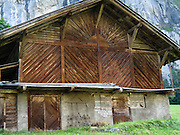 """Wood planks make a sun pattern in a hay barn in Lauterbrunnen Valley (795 m or 2608 ft) in the Berner Oberland, Switzerland, the Alps, Europe. Take trains from Zurich to Interlaken Ost to Lauterbrunnen. The Bernese Highlands are the upper part of Bern Canton. UNESCO lists """"Swiss Alps Jungfrau-Aletsch"""" as a World Heritage Area (2001, 2007)."""