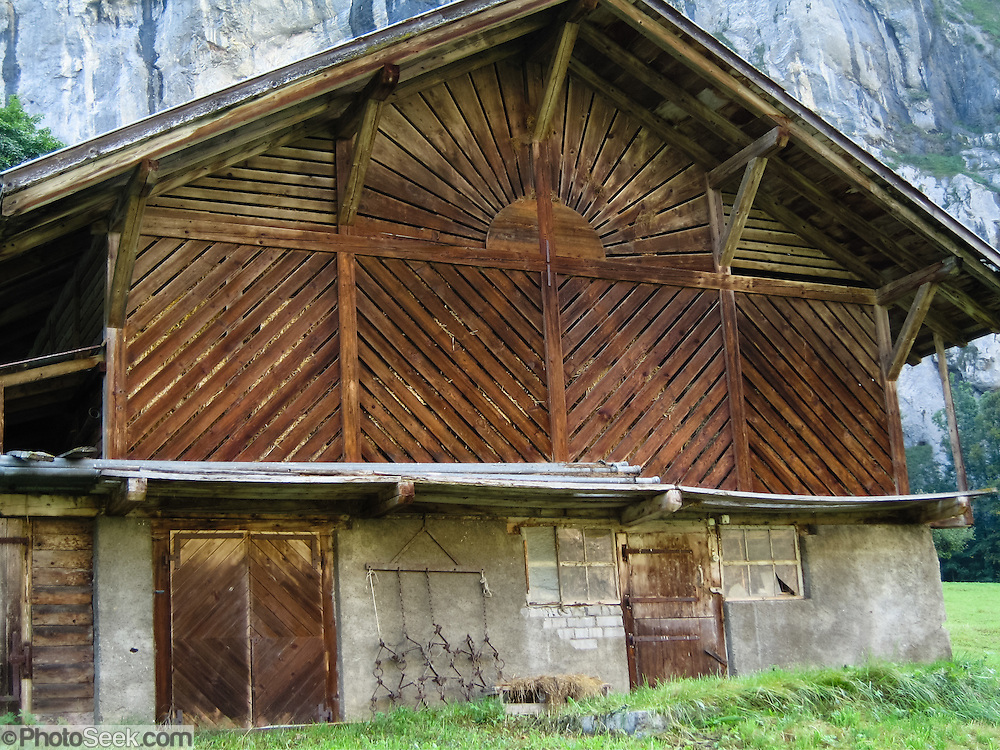 "Wood planks make a sun pattern in a hay barn in Lauterbrunnen Valley (795 m or 2608 ft) in the Berner Oberland, Switzerland, the Alps, Europe. Take trains from Zurich to Interlaken Ost to Lauterbrunnen. The Bernese Highlands are the upper part of Bern Canton. UNESCO lists ""Swiss Alps Jungfrau-Aletsch"" as a World Heritage Area (2001, 2007)."