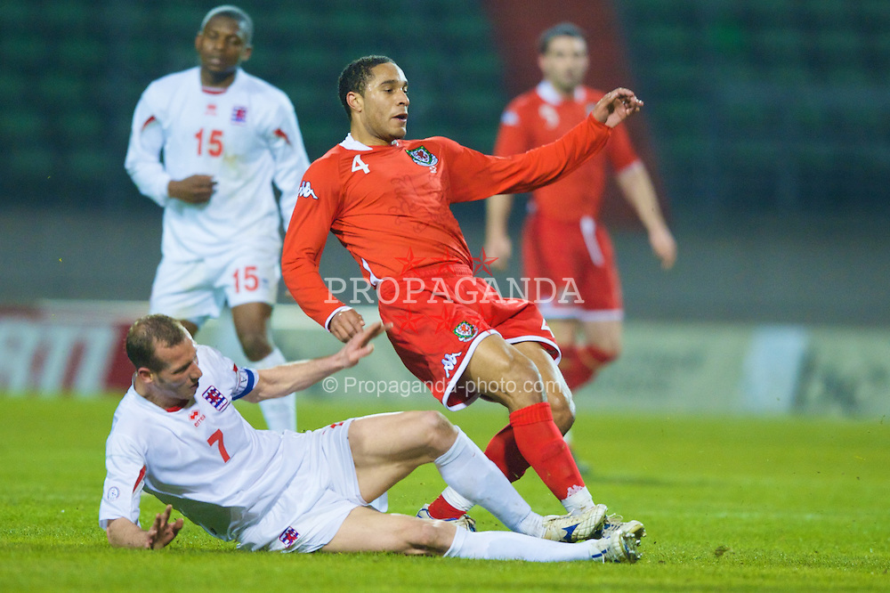 LUXEMBOURG CITY, LUXEMBOURG - Wednesday, March 26, 2008: Wales' Ashley Williams clashes with Luxembourg's captain Jeff Strasser during the International Friendly match at the Stade Josy Barthel. (Photo by David Rawcliffe/Propaganda)