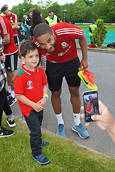 CARDIFF, WALES - Wednesday, June 1, 2016: Wales' captain Ashley Williams poses for a picture with a supporter after a training session at the Vale Resort Hotel ahead of the International Friendly match against Sweden. (Pic by David Rawcliffe/Propaganda)