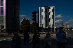 © Licensed to London News Pictures . 11/10/2018. Salford , UK . GV of Thorn Court (l) and Spruce Court (c) with temporary cladding fitted on the bottom three floors and unsafe cladding remaining in place above . Recently installed cladding at several council-owned tower blocks in Salford has been identified as having similar dangerous properties to that which was installed on the Grenfell Tower in London . Residents have been waiting months for clarification on what action will be taken to make their homes safe . Photo credit : Joel Goodman/LNP