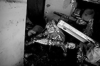 The leg of a elderly man still inside his home in the lower ninth ward over a month after hurricane katrina made lanfall 8 October 2005 New Orleans Louisiana.  (photo by Darren Hauck)