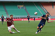AC Milan's Belgian midfielder Alexis Saelemaekers crosses the ball as AS Roma's French midfielder Jordan Veretout closes in during the Serie A match at Giuseppe Meazza, Milan. Picture date: 28th June 2020. Picture credit should read: Jonathan Moscrop/Sportimage
