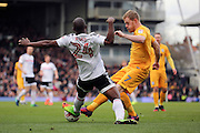 Fulham striker Sone Aluko (24) battles for possession with Preston North End midfielder Daryl Horgan (7) during the EFL Sky Bet Championship match between Fulham and Preston North End at Craven Cottage, London, England on 4 March 2017. Photo by Matthew Redman.