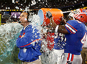 Florida Siler LB Brandon Siler dumps the Gatorade bucket on head coach Urban Meyer during the SEC Championship game between the Arkansas Razorbacks and the Florida Gators at the Georgia Dome in Atlanta, GA on December 2, 2006.<br />