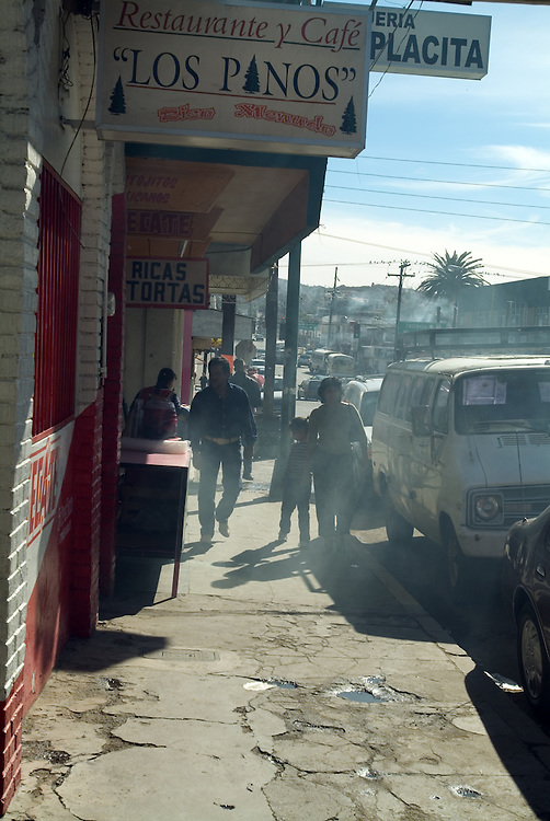 Family walking along street in Tecate, Mexico