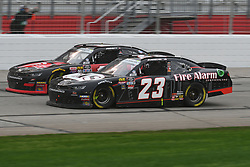 February 23, 2019 - Hampton, GA, U.S. - HAMPTON, GA - FEBRUARY 23: John Hunter Nemecheck, GMS Racing, Chevrolet Camaro Fire Alarm Services (23) and Michael Annett, JR Motorsports, Chevrolet Camaro Chevrolet Pilot Flying J (1) race side by side during the Xfinity Series Rinnai 250 on February 23, 2019, at Atlanta Motor Speedway in Hampton, GA.(Photo by Jeffrey Vest/Icon Sportswire) (Credit Image: © Jeffrey Vest/Icon SMI via ZUMA Press)