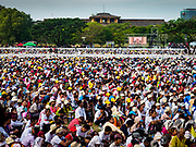 29 NOVEMBER 2017 - YANGON, MYANMAR:  People listen to Pope Francis' homily (the Pope is on the TV screen in the background) during the Papal Mass in Yangon. Hundreds of thousands of Catholics from Myanmar attended the mass said by Pope Francis at Kyaikkasan Sports Ground in Yangon Wednesday. Pope Francis is on the first visit by a Pope to Myanmar.   PHOTO BY JACK KURTZ
