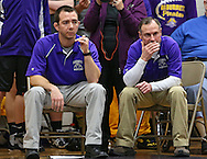 Alburnett head coach Kane Thompson (from left) and assistant Brett Shulista watch the action in the Class 1A Wrestling Regional semifinals between Alburnett and Iowa City Regina at Alburnett High School in Alburnett on Tuesday, February 5, 2013. (Stephen Mally/Freelance)