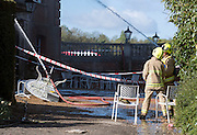 © Licensed to London News Pictures. 30/04/2015. Surrey, UK. Fire officers at the scene of the fire today 30 April 2015. A fire at the National Trust-run Clandon Park House, near Guildford, is thought to have started in the basement just after 16:00 BST on Wednesday. Photo credit : Stephen Simpson/LNP
