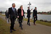© Licensed to London News Pictures. 27/02/2012, Windsor, UK. (L-R ) JOHN TURNBULL of Thames Valley Police. THERESA MAY, JOHN KELLY, Venue Operations Manager London 2012, JOSS CARTER Venue Security Manager 2012 walk along the course for Olympic Rowing evens. Home Secretary Theresa May visits Eton College Rowing Centre in Windsor today 27 february 2012 to see the preparations being made ahead of the London Olympic and Paralympic Games. Photo credit : Stephen Simpson/LNP