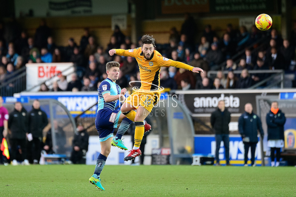 Newport County midfielder (on loan from Swansea) Josh Sheehan (16) heads the ball during the EFL Sky Bet League 2 match between Wycombe Wanderers and Newport County at Adams Park, High Wycombe, England on 2 January 2017. Photo by Dennis Goodwin.