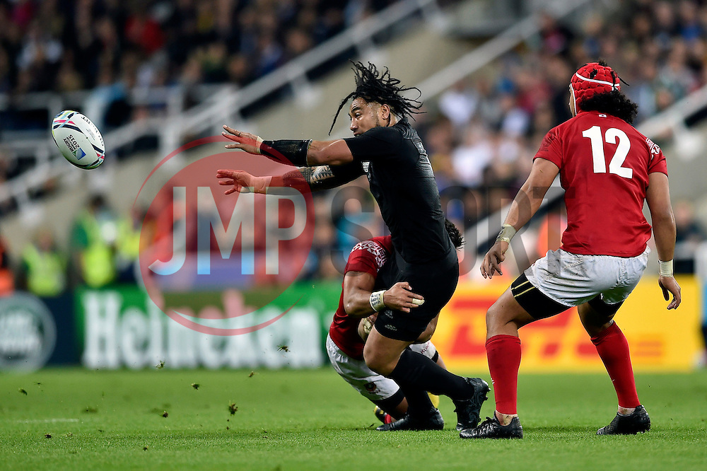 Ma'a Nonu of New Zealand offloads the ball - Mandatory byline: Patrick Khachfe/JMP - 07966 386802 - 09/10/2015 - RUGBY UNION - St James' Park - Newcastle, England - New Zealand v Tonga - Rugby World Cup 2015 Pool C.
