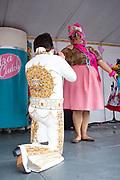 Elvis impersonator Tommy Barnes serenades Amber Nelson, Baltimore's Best Hon 2018, during Honfest on Sunday, June 10, 2018 in Baltimore, MD.