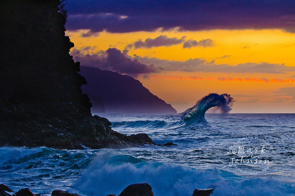 Wave breaking off the Na Pali coast of Kauai, Hawaii
