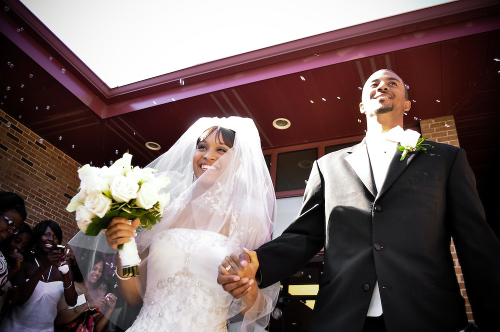 Cassie & Ernest are received with bubbles as they exit Covenant United Church of Christ in South Holland, IL