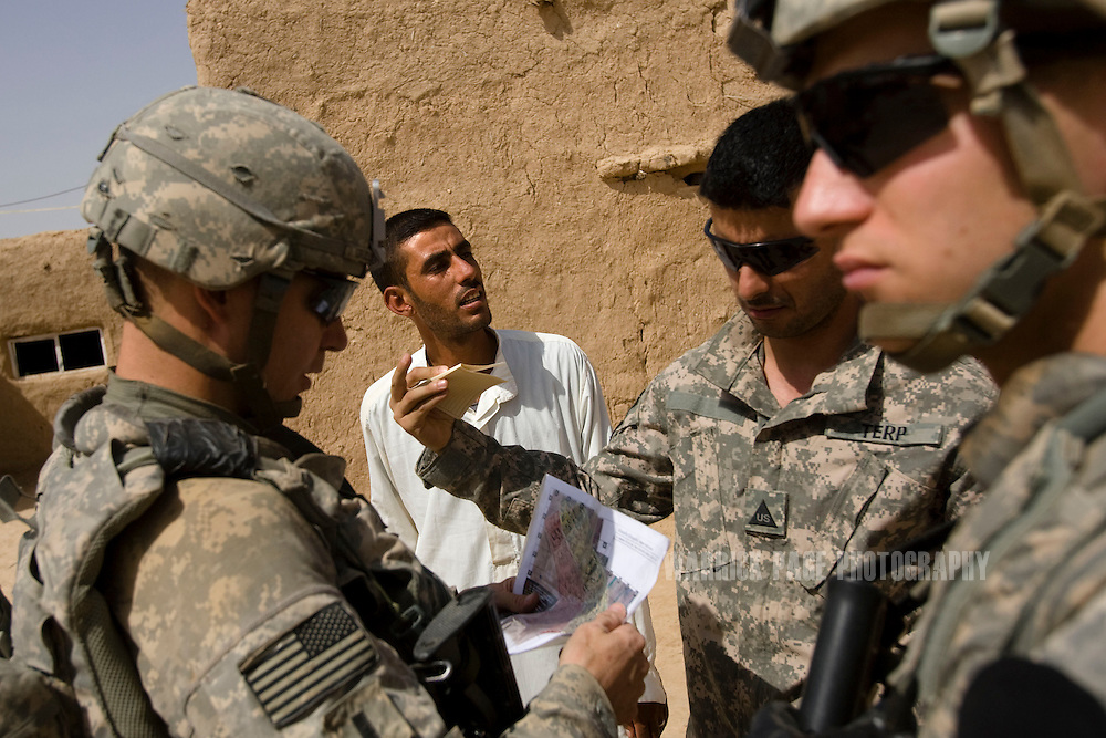 ALI AYUN, IRAQ - JUNE 11: US soldiers with Bronco Troop, 1st Squadron, 14th Cavalry Regiment, speak with a local to gather intelligence on insurgent activity, on June 11, 2010, in Ali Ayun, Diyala Province, Iraq. Iraq faces multiple challenges in the lead-up to the drawn-down of US forces in Iraq, with many observers claiming that while they have the capablities of handling home-grown problems, they are far from being able to tackle external threats. Political wrangling has reportedly fostered greater instability throughout the country with fears of renewed sectarian violence breaking out as insurgents set-up attacks in an attempt to exploit vulnerabilities amongst the populace. (Photo by Warrick Page)