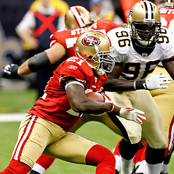 August 12, 2011; New Orleans, LA, USA; San Francisco 49ers running back Frank Gore (21) during the first half of a preseason game against the New Orleans Saints at the Louisiana Superdome. Mandatory Credit: Derick E. Hingle