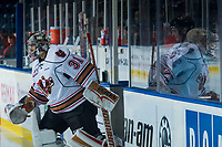KELOWNA, CANADA - OCTOBER 13: Nick Schneider #31 of the Calgary Hitmen enters the ice against the Kelowna Rockets on October 13, 2017 at Prospera Place in Kelowna, British Columbia, Canada.  (Photo by Marissa Baecker/Shoot the Breeze)  *** Local Caption ***