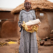 At approximately 95 years of age, Poakurugu Bukari is the oldest resident of the Gambaga camp for alleged witches. She has lived in the camp for 30 years, but still hopes her children will come one day and take her home. Fearful of dying away from her family, she has purchased her own burial shroud, lest she die and there be no-one to provide it for her.