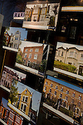 Images of properties on view in the window of Hampton's International in Clapham High Street, south London.