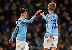 Manchester City's Brahim Diaz (left) celebrates scoring his side's second goal of the game with Oleksandr Zinchenko during the Carabao Cup, Fourth Round match at the Etihad Stadium, Manchester.