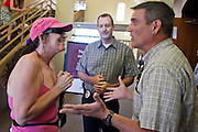 Aug 26, 2009 -- PHOENIX, AZ: MARIE RAMIREZ (left) and Phoenix police Sgt. BRIAN MURRAY discuss her ejection from a town hall meeting on health care at North Phoenix Baptist Church in Phoenix, AZ, Wednesday. The meeting was sponsored by Sen John McCain. Sen McCain hosted his second town hall meeting on health care in two days Wednesday. About 1,000 people attended the meeting. Although most were opposed to President Obama's health care proposals and supported Sen McCain, there was a large group who support the President's health care efforts.  Photo by Jack Kurtz