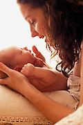 Mom and newborn baby bonding