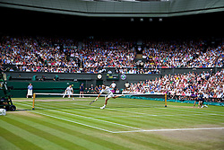 LONDON, ENGLAND - Sunday, July 6, 2014: Roger Federer (SUI) returns to Novak Djokovic (SRB) during the Gentlemen's Singles Final match on day thirteen of the Wimbledon Lawn Tennis Championships at the All England Lawn Tennis and Croquet Club. (Pic by David Rawcliffe/Propaganda)