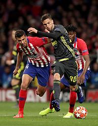 Atletico Madrid's Rodri, (left) battles for possession of the ball with Juventus'  Rodrigo Bentancur, (right)