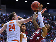 SAN DIEGO, CA - MARCH 16:  A.J. Harris #12 of the New Mexico State Aggies is fouled by David Skara #24 of the Clemson Tigers during a first round game of the Men's NCAA Basketball Tournament at Viejas Arena in San Diego, California. Clemson won 79-68.  (Photo by Sam Wasson)