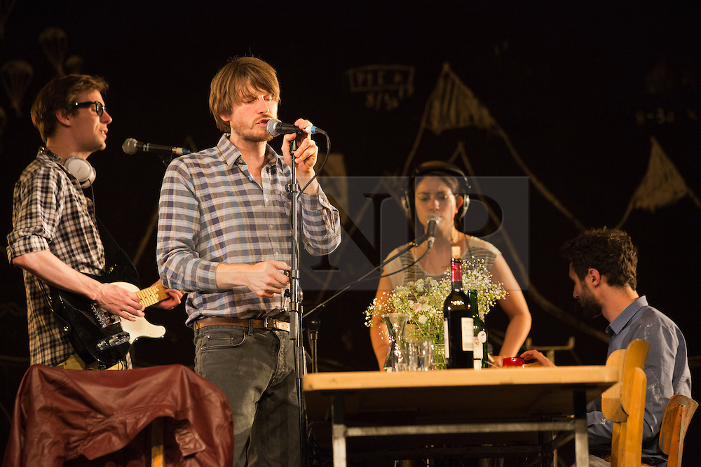 "© Licensed to London News Pictures. 24/09/2014. London, England. L-R: Moritz Gottwald; Christoph Gawenda, Eva Meckbach and Renato Schuch. German theatre company Schaubühne Berlin present an adaptation of ""An Enemy of the People"" by Henrik Ibsen at the Barbican Theatre, Barbican Centre, from 24-28 September 2014. The play is directed by Thomas Ostermeier and part of the International Ibsen Season. Photo credit: Bettina Strenske/LNP"