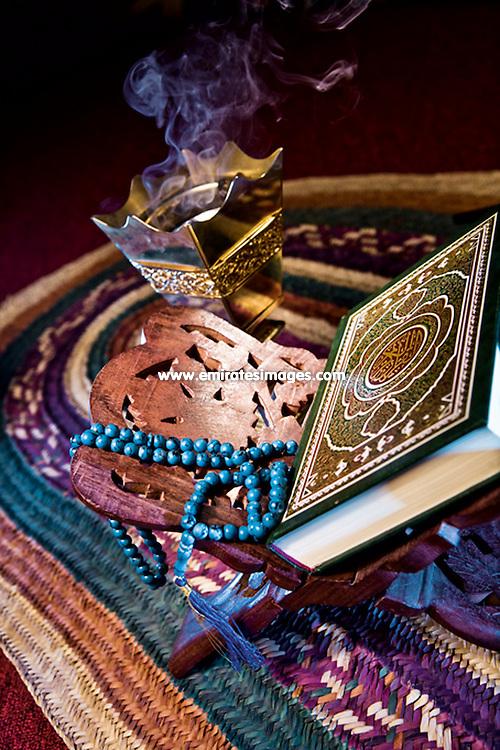 Ramadan setting with Quran, prayer beads, oud