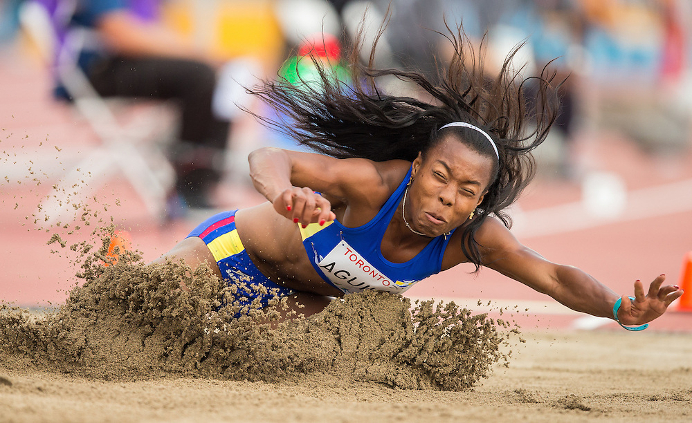 Evelis Aguilar of Colombia competes in the long jump event of the women's heptathlon at the 2015 Pan American Games at CIBC Athletics Stadium in Toronto, Canada, July 25,  2015.  AFP PHOTO/GEOFF ROBINS