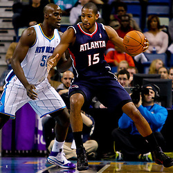 December 26, 2010; New Orleans, LA, USA; Atlanta Hawks center Al Horford (15) is guarded by New Orleans Hornets center Emeka Okafor (50) during the first quarter at the New Orleans Arena.  Mandatory Credit: Derick E. Hingle