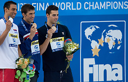 Second placed Milorad Cavic of Serbia, Winner Michael Phelps of USA and third placed Rafael Munoz Perez of Spain at the victory ceremony after the Men's  100m Butterfly Final during the 13th FINA World Championships Roma 2009, on August 1, 2009, at the Stadio del Nuoto,  in Foro Italico, Rome, Italy. (Photo by Vid Ponikvar / Sportida)