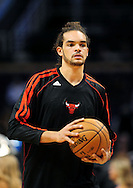 Nov. 14, 2012; Phoenix, AZ, USA; Chicago Bulls center Joakim Noah (13) warms up prior to the game against the Phoenix Suns at the US Airways Center.  The Bulls defeated the Suns 112-106 in overtime. Mandatory Credit: Jennifer Stewart-USA TODAY Sports