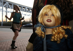 29 Jan 2012. New Orleans, Louisiana USA. <br /> A Lara Croft character passes an Anne Rice mannequin  as comic book characters gather at the Wizard World New Orleans Comic Con at the Ernest N Morial Convention Center. <br /> Photo; Charlie Varley/varleypix.com