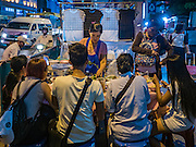 28 JULY 2016 - BANGKOK, THAILAND:    Street vendors on Ratchadamri Road near CentralWorld mall in Bangkok. Bangkok city authorities have promised to evict the vendors by August 1, 2016.       PHOTO BY JACK KURTZ