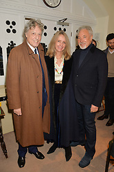 Left to right, SIR TOM STOPPARD, LADY STOPPARD and SIR TOM JONES at the charity Child Bereavement UK's 21st Anniversary Christmas Carol Concert held at Holy Trinity Brompton, London on 10th December 2015.
