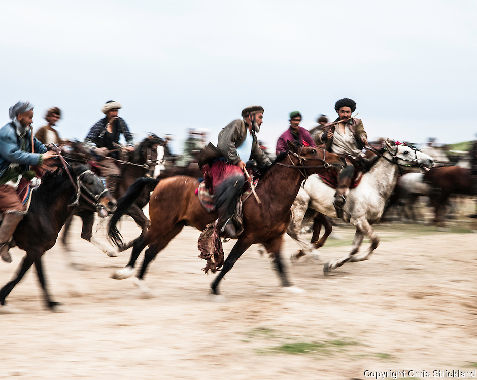 Pul-i-Khumri, Baghlan, Afghanistan, 2010. Afghan men playing the traditonal Asian sport of Buzkashi.