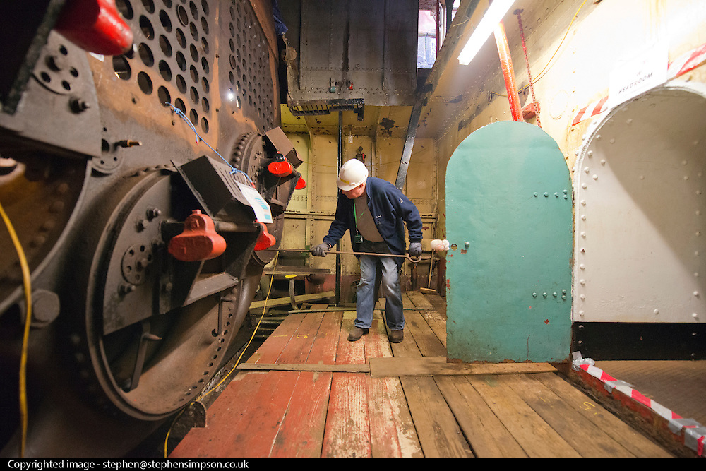 ****COPY HERE****  (https://www.dropbox.com/s/5mg81qiiuy22tre/adamson.rtf?dl=0)   © Licensed to London News Pictures. 02/12/2014. Liverpool , UK .  Volunteer Kev Lytton works on the enormous boiler. The only surviving steam powered tug tender, the Daniel Adamson, is being completely renovated by a team of volunteers in Liverpool. The vessel, which has had 90,000 man hours already spent on it, was bought for only one pound is the awaiting the decision of the Heritage LotteryFund on an application of £3.6m to bring her back to her full glory.  . Photo credit : Stephen Simpson/LNP<br /> <br /> COPY HERE https://www.dropbox.com/s/5mg81qiiuy22tre/adamson.rtf?dl=0