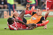 Jake Livermore of Hull City and Albert Adomah of Middlesbrough FC bring each other down during the Sky Bet Championship match between Hull City and Middlesbrough at the KC Stadium, Kingston upon Hull, England on 7 November 2015. Photo by Ian Lyall.