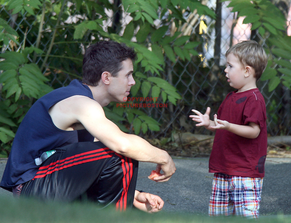 """(08/03/06-Medford,MA) The Last few hours of filming for Ben Affleck's """"Gone Baby Gone"""" finds Casey Affleck and his son (name to come) playing outside Loconte Rink where filming is wrapping up.(080306affleckmg-Staff photo:Mark Garfinkel.saved fri/remote)"""