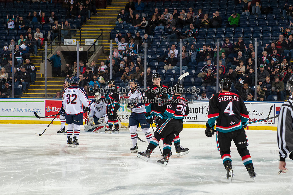 KELOWNA, CANADA - DECEMBER 5:  Nolan Foote #29, Liam Kindree #26 and Devin Steffler #4 of the Kelowna Rockets celebrate a second period goal against the Tri-City Americans on December 5, 2018 at Prospera Place in Kelowna, British Columbia, Canada.  (Photo by Marissa Baecker/Shoot the Breeze)