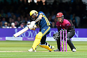 Gareth Berg of Hampshire hits the ball to the boundary for four runs during the Royal London 1 Day Cup Final match between Somerset County Cricket Club and Hampshire County Cricket Club at Lord's Cricket Ground, St John's Wood, United Kingdom on 25 May 2019.