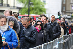 © Licensed to London News Pictures. 27/04/2019. London, UK. Long queue of voters outside High Commission of South Africa in London waiting to cast their vote in this year's general election. Over 9000 South Africans have registered to vote in the UK, which is the highest number of registered voters living abroad. The Electoral Commission has extended voting hours for South African citizens in London until 11:30 pm on Saturday night because of the Vaisakhi Festival at Trafalgar square. <br /> <br /> General elections will be held in South Africa on 8 May 2019 to elect a new National Assembly and provincial legislatures in each province<br /> <br /> Photo credit: Dinendra Haria/LNP
